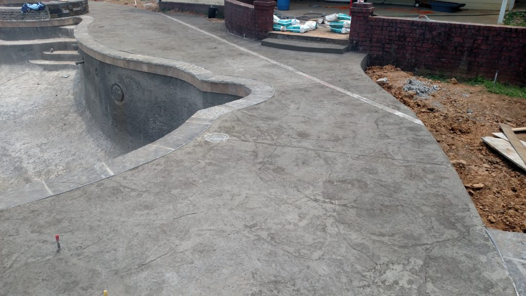 deck construction with gray stamped and stained concrete