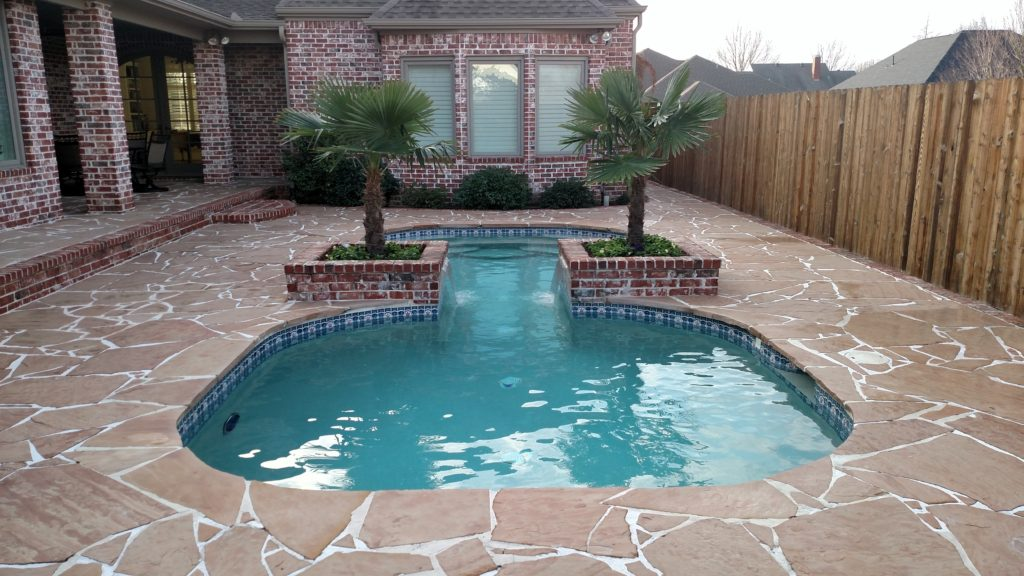 flagstone deck with small pool next to house
