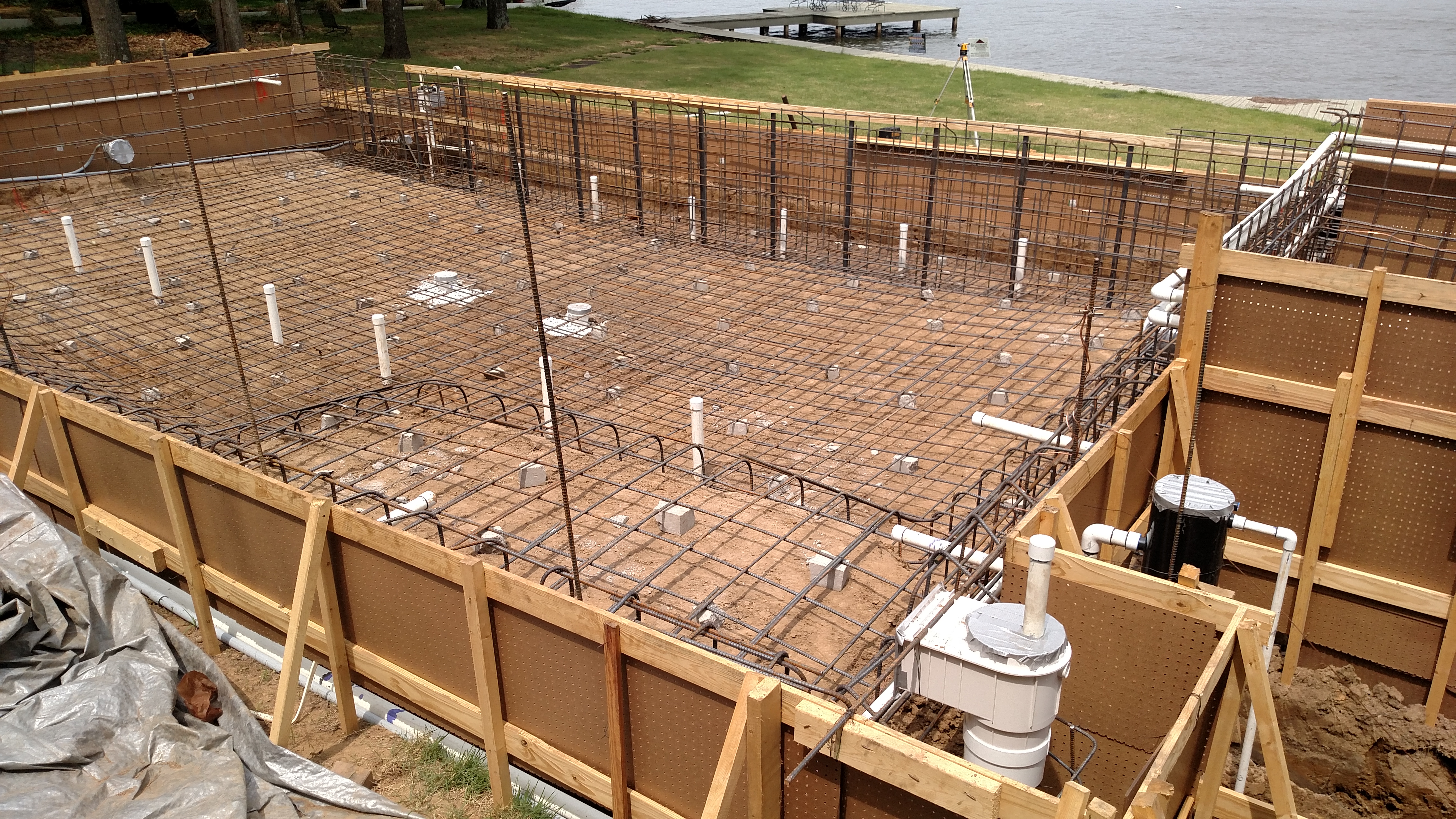 tying steel and running plumbing to the pool