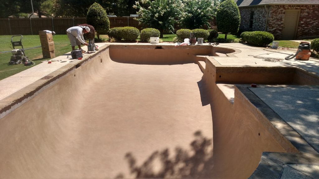 pool renovation with stamped and stained conrete sun pad and new plaster (2)